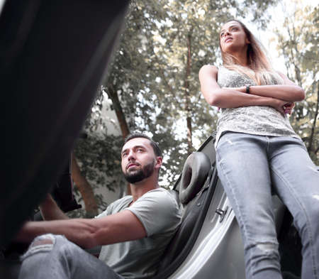 young couple traveling by car makes a stop