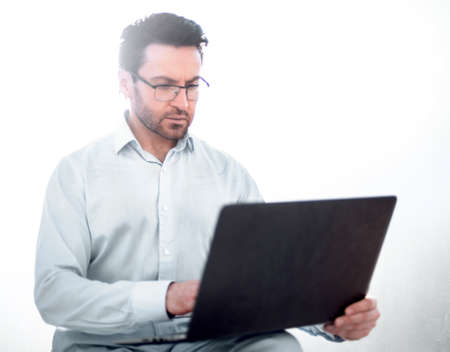 close up.modern businessman is using a laptop.