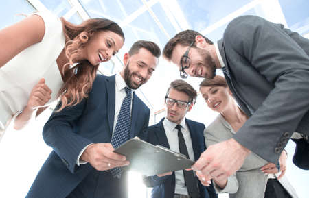 business team looking at the clipboard with the financial report Stock Photo