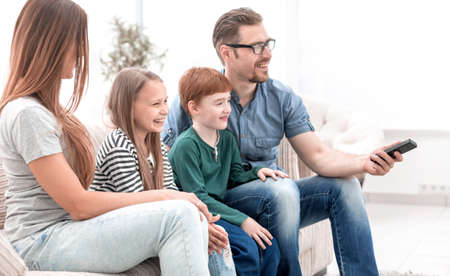family watches TV in the modern living room 版權商用圖片