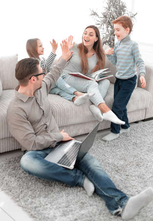 cheerful family spends their leisure time in their living room