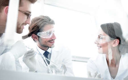 Group of scientists working on an experiment at the laboratory Stock Photo