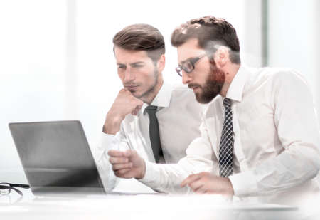 two business colleagues discuss online information