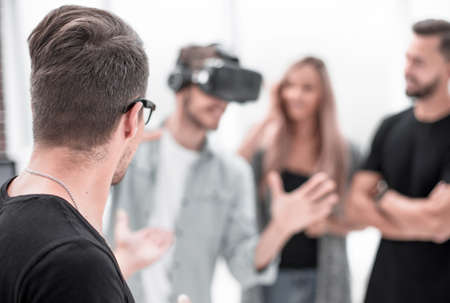 Positive colleagues testing virtual reality glasses 写真素材