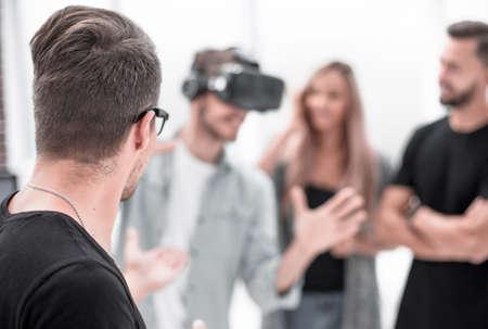 Positive colleagues testing virtual reality glasses Фото со стока