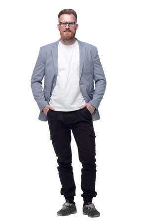 confident business man with hands in pockets . isolated on white