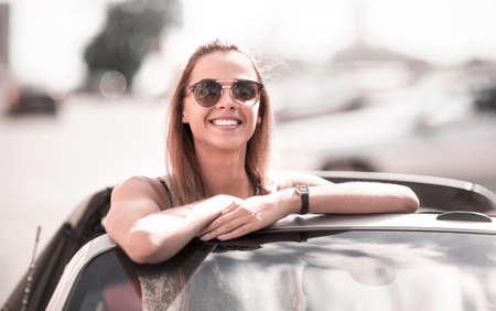 modern girl enjoying a trip in a convertible