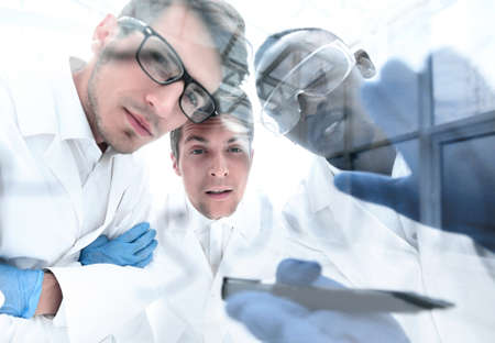 close up.a group of scientists discussing the results of the experimen 写真素材