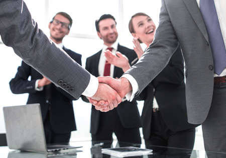 business handshake of business partners after signing the contract 写真素材