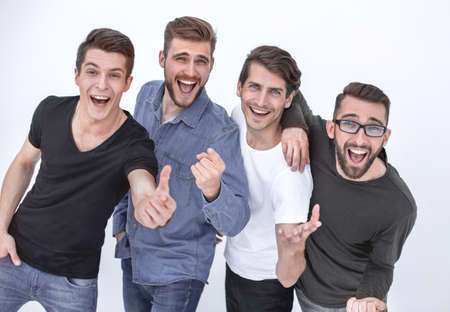 casual men pointing at camera on white background