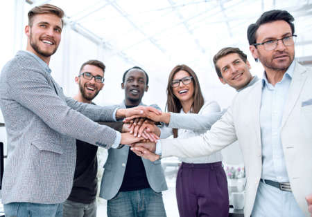 Business People teamwork stacking hands showing unity
