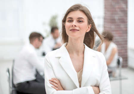 dreams of a young business woman standing in office