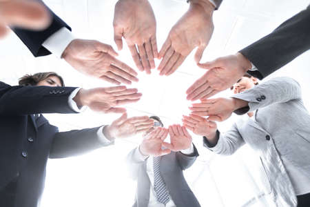 business team with folded their hands in a circle