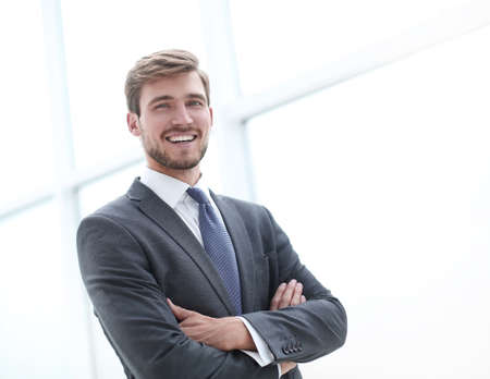 close up.serious young businessman standing in office. Stock fotó