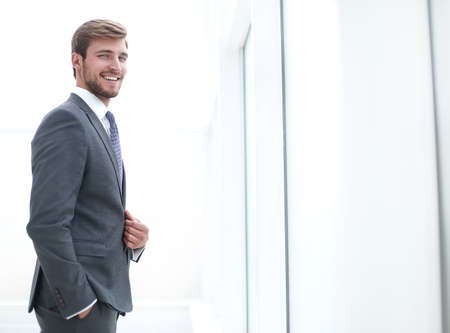 close up. focused young businessman standing in office
