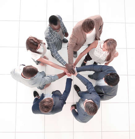 top view.the business team shows its unity