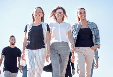 group of young people, confidently stepping forward Stockfoto