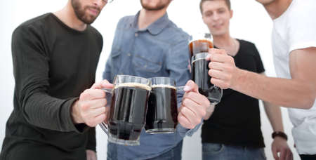 guys with mugs of beer isolated on white background
