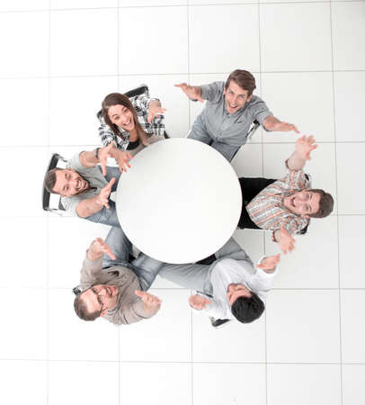 top view. business team holding up their hands and looking at the camera Stock Photo