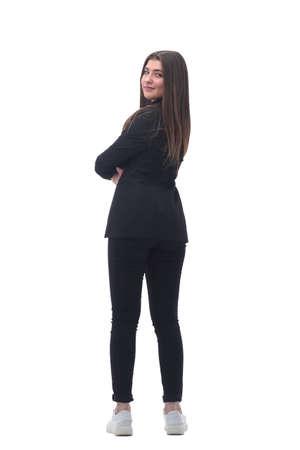 vista trasera. mujer de negocios joven mirando hacia adelante Foto de archivo
