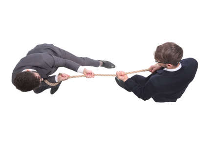 top view. two young businessmen pulling the rope