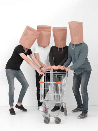 group of people with empty shopping carts.