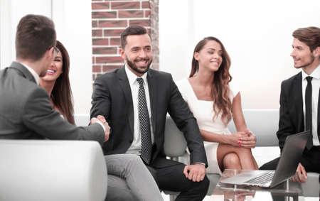 handshake business partners in an informal meeting Reklamní fotografie