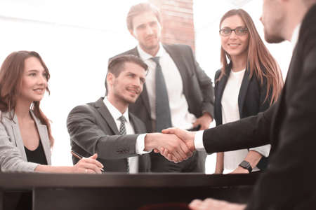 Handshake between employees after the meeting