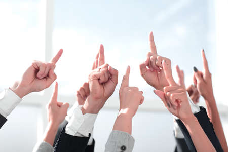 close up. a group of business people pointing up Stock Photo