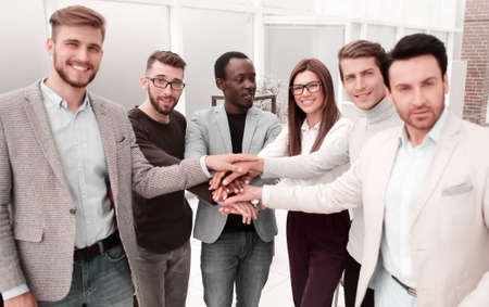business team doing a bunch of hands at a meeting Stock Photo