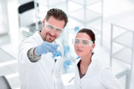 scientist and assistant look at the results of their research