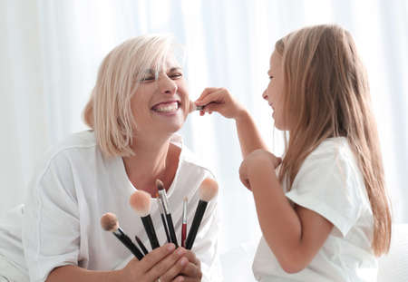 mom and her young daughter are preparing to make mikej together.