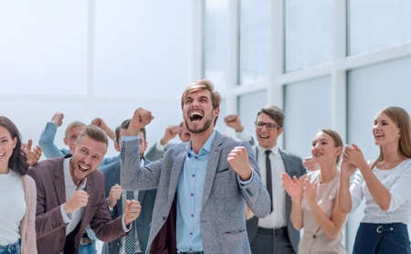 cheerful employees congratulating a colleague on the promotion
