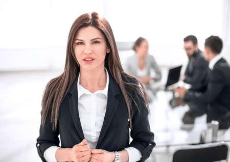 young business woman on the background of the office Stok Fotoğraf