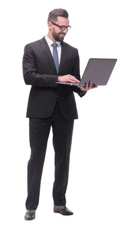in full growth. businessman with open laptop. Foto de archivo - 130773643