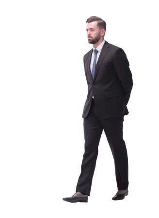 rear view. pensive businessman stepping forward . isolated on white Foto de archivo - 130740876