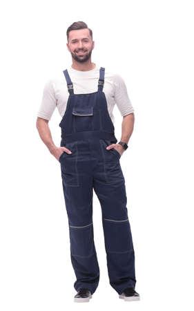 in full growth. smiling man in overalls. Foto de archivo - 130740871