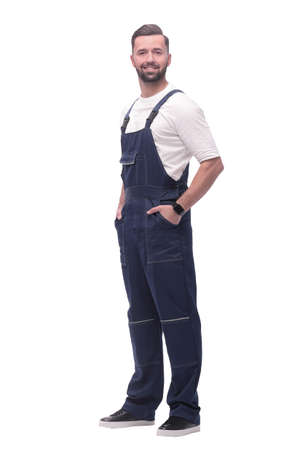 in full growth. smiling man in overalls. Foto de archivo - 130740873