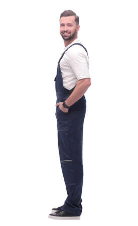 side view. smiling man in blue overalls. isolated on white Foto de archivo - 130740872