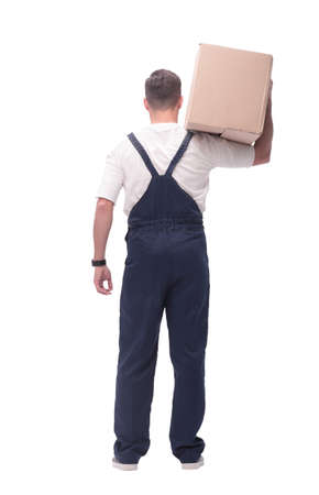 rear view. a young man with a large cardboard box Foto de archivo - 130741298