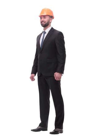 in full growth. successful businessman in a protective helmet Foto de archivo - 130741340