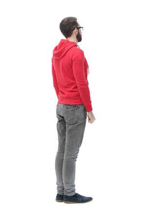 achteraanzicht. moderne trendy man op zoek naar een kopieerruimte