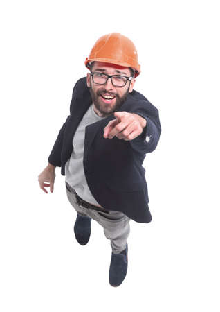 top view. engineer architect in helmet pointing at you