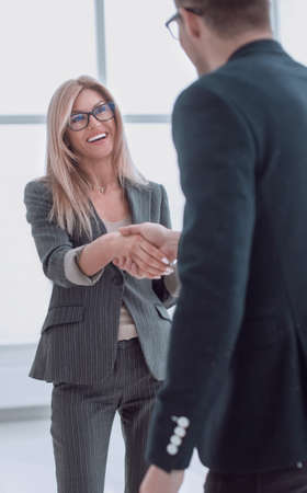 business man meets a woman with a handshake