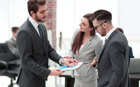 A satisfied business lady explains the statistics chart