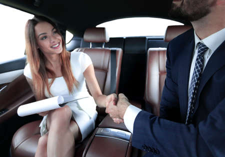 Businessman was congratulated in the car for completing the job Stock fotó