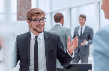 smiling young businessman at the workplace office.