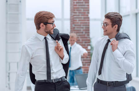 business colleagues discussing something in the workplace