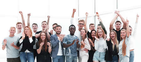 team of happy young people showing their success