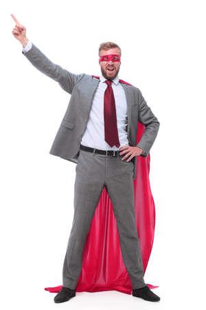 confident superhero businessman pointing to copy space. Stock Photo